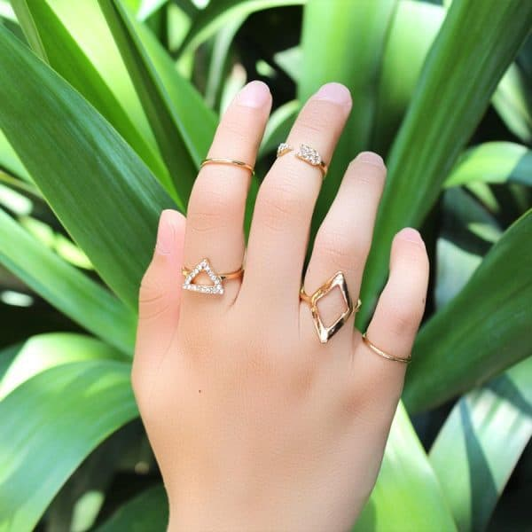 5 Pcs Gold Triangle Ring set.click hear to shop more beautiful rings. Shop all musthave jewellery by aphrodite. Free worldwide shipping and gift.
