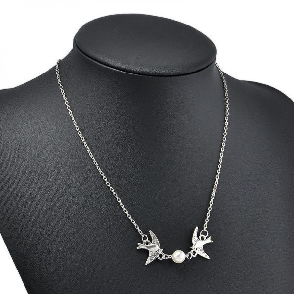 Silver Birds Necklace With Pearl. Click hear for more beautiful necklaces.Shop all musthave jewellery by aphrodite.Free worldwde shipping and gift.