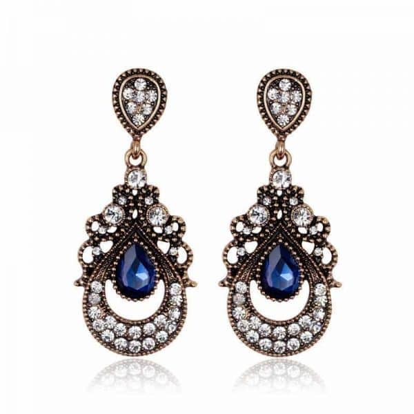 Blue Gemstone Chandelier Earrings. Click here for more statement earrings. Shop all musthave jewellery by Aphrodite. Free worldwide shipping and gift.