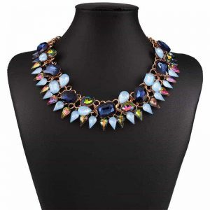 Statement Necklace With Blue Crystals. Click here for more beautiful statement necklaces. Shop all musthave jewellery by Aphrodite. Free worldwide shipping.