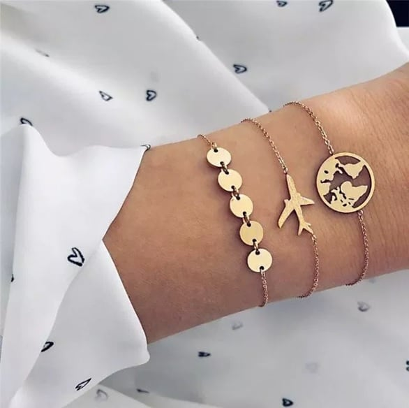 bracelet set. coin, plane, world map, jewellery