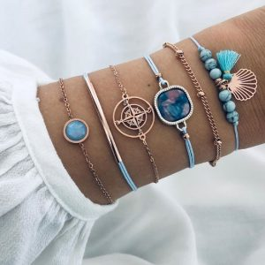 bracelet set, gold, jewellery, jewelry, compass, shell, blue tassel