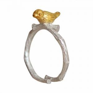 Gold Bird On Silver Branch Ring. Click here for more beautiful silver and gold rings. Shop all musthave jewellery by Aphrodite. Free worldwide shipping.