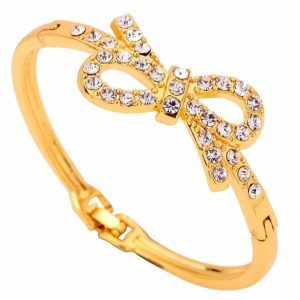 Golden Bow Bracelet. Click here for more beautiful cuff bracelets. Shop all musthave jewellery by Aphrodite. Free worldwide shipping and gift.