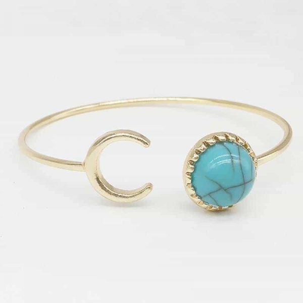 Gold Cuff Bracelet With Moon And Marble. Click here for more cuff bracelets. Shop all musthave jewellery by Aphrodite. Free worldwide shipping and gift.