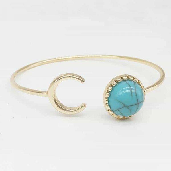 Goud Cuff Armband Met Maan En Marmer.Klik hier voor meer leuke armbanden.Shop alle musthave sieraden bij aphrodite. Gratis verzending en cadeau.
