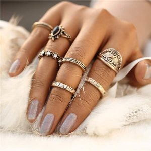 7 Pcs Gold Ring Set With Black Stone. click hear to shop more beautiful rings. Shop all musthave jewellery by aphrodite. Free worldwide shipping and gift.