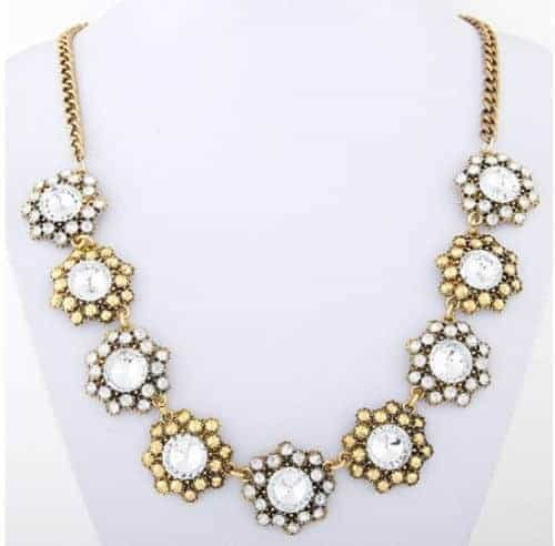 Gold With Silver Statement Necklace. click hear to shop more statement necklaces. Shop all musthave jewellery by aphrodite. Free worldwide shipping.