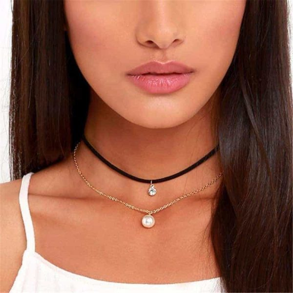 Layered Choker With Crystal And Pearl Pendant. Click here for more chokers. Shop all musthave jewellery by Aphrodite. Free worldwide shipping and gift.