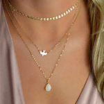 layered necklace, disc, stone, bird, gold