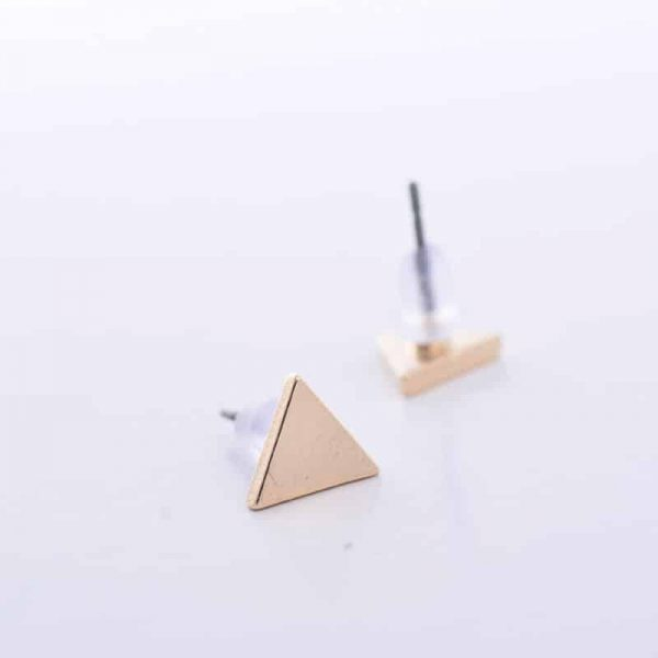 Gold Triangle Ear studs.Click here for more delicate earrings. Shop all musthave jewellery by Aphrodite. Free worldwide shipping and gift.