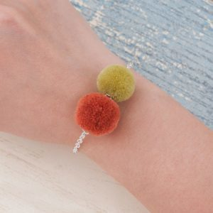 Double Pom Pom Bracelet. Click here for more beautiful bracelets. Shop all musthave jewellery by Aphrodite. Free worldwide shipping and gift.