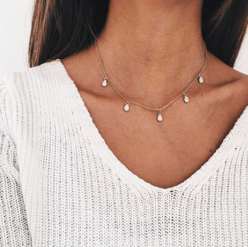Necklace With Crystal Drops-Gold And Silver.Click here for more delicate necklaces. Shop all musthave jewellery by Aphrodite. Free worldwide shipping.