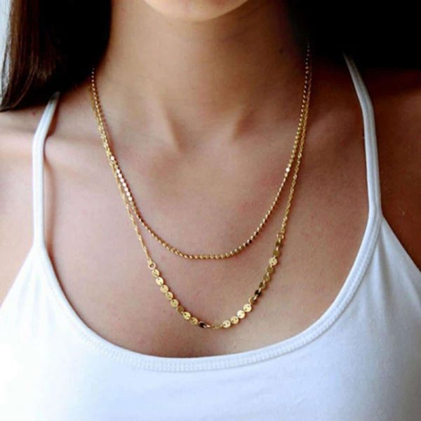 Layered Necklace With Small Gold Discs. Click hear for more beautiful layered necklaces.Shop all musthave jewellery by aphrodite.Free worldwide shipping.