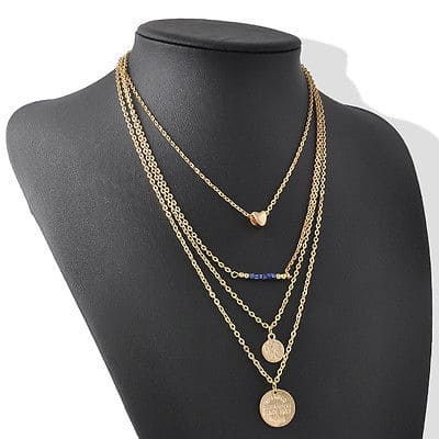 Layered Heart And Disc Necklace. Click here for more beautiful layered necklaces. Shop all musthave jewellery by Aphrodite. Free worldwide shipping.
