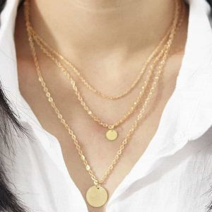 Layered Necklace With Gold Discs. Click hear for more beautiful layered necklaces.Shop all musthave jewellery by aphrodite.Free worldwide shipping.