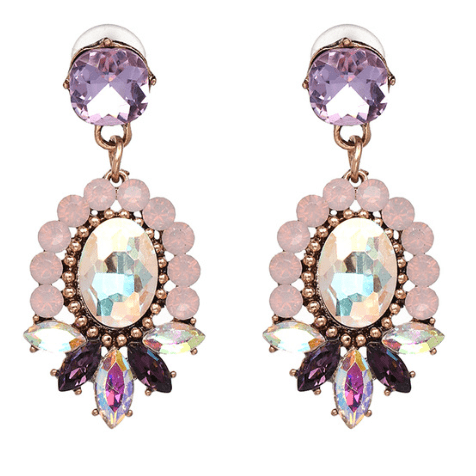 Statement Earrings With Crystals- Purple. Click here for more beautiful statement earrings. Shop all musthave jewellery by Aphrodite. Free shipping.