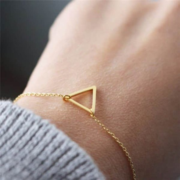 Delicate Gold Triangle Bracelet. Click here for more delicate bracelets. Shop all musthave jewellery by Aphrodite. Free worldwide shipping and gift.